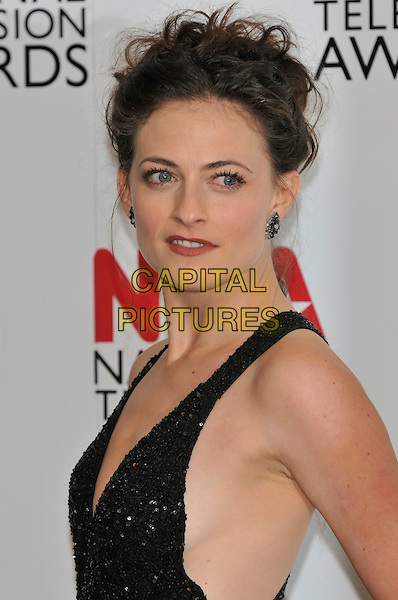 Lara Pulver .at the National TV Awards 2012 at the O2 Arena, London, England, UK,.25th January 2012..NTA NTAs press room portrait headshot  black dress side sparkly .CAP/PL.©Phil Loftus/Capital Pictures.