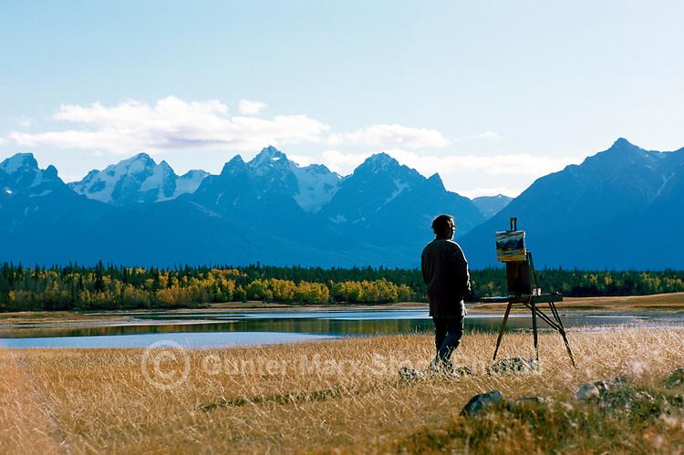 Cariboo Chilcotin Coast Region, BC, British Columbia, Canada - Painter painting Scenic Landscape
