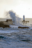 Pictured: Waves crash into a lighthouse in Porthcawl, Wales, UK. Thursday 07 February 2019<br /> Re: Warnings of strong wind were in place across the whole of Wales starting Wednesday night.<br /> A yellow &quot;be aware&quot; weather warning was issued from 10pm on Wednesday until 9am on Thursday.<br /> may be delayed on exposed routes.