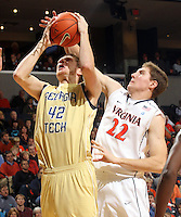 Jan. 22, 2011; Charlottesville, VA, USA; Virginia Cavaliers forward Will Sherrill (22) fouls Georgia Tech Yellow Jackets center Nate Hicks (42) during the game at the John Paul Jones Arena. Mandatory Credit: Andrew Shurtleff-US PRESSWIRE