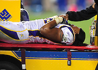 Dec 6, 2009; Glendale, AZ, USA; Minnesota Vikings linebacker E.J. Henderson is carted off the field on a stretcher after suffering an injury in the fourth quarter against the Arizona Cardinals at University of Phoenix Stadium. The Cardinals defeated the Vikings 30-17. Mandatory Credit: Mark J. Rebilas-