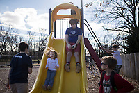 NWA Democrat-Gazette/CHARLIE KAIJO Sarah Lundy, 6, of Bentonville and staff member Cade Conner of Bella Vista (from center left) ride down a slide, Monday, January 7, 2019 at the Boys and Girls Club in Bentonville. <br />