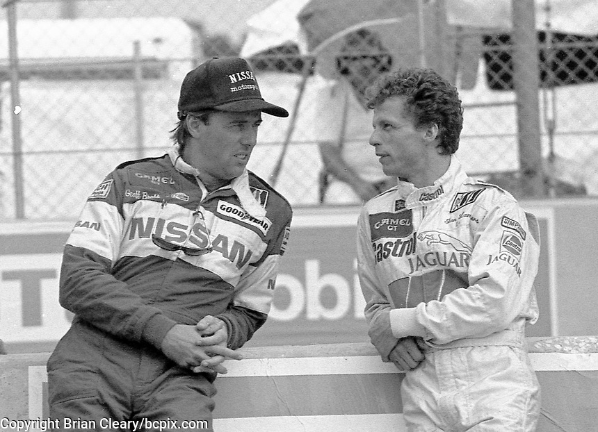 Geoff Brabham, left, and Jan Lammers talk before the IMSA GTP/Lights race at the Florida State Fairgrounds in Tampa, FL, October 1, 1989. (Photo by Brian Cleary/www.bcpix.com)