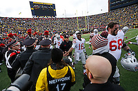 Ohio State players, including offensive lineman Taylor Decker (68) and quarterback J.T. Barrett (16) walk back to the locker room prior to the NCAA football game at Michigan Stadium in Ann Arbor on Nov. 28, 2015. Ohio State won 42-13. (Adam Cairns / The Columbus Dispatch)