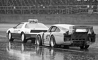 The #47 Porsche of Frank Rubino, Pepe Romero, Doc Bundy and Dale Whittington waits behind the pace car on pit road during a red flag in the rain at the 1983 24 Hours of Daytona , Daytona Internationa Speedway, Daytona Beach, FL, February 1-2, 1983.  (Photo by Brian Cleary / www.bcpix.com)