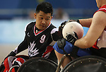 Say Luangkhamdeng of Surrey, B.C. tries to get the ball away from a player from Great Britain in the bronze medal game in wheelchair rugby action in Beijing during the Paralympic Games, Tuesday, Sept., 16, 2008.  Photo by Mike Ridewood/CPC
