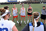 DURHAM, NC - FEBRUARY 16: Campbell's Mackenzie Koeller (3), Kayla Reilly (20), and Megan Reilly (10). The Duke University Blue Devils hosted the Campbell University Camels on February 16, 2018, at Koskinen Stadium in Durham, NC in women's college lacrosse match. Duke won the game 18-8.