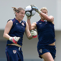 USWNT goalkeeper Hope Solo pulls the ball away from the head of teammate Nicole Barnhart during practice at Anyang Sports Center in Seoul, South Korea.