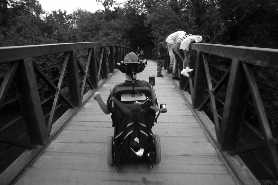 Sean Pevsner cruises over a bridge along the Barton Creek Greenbelt in Austin, Texas.<br /> <br /> Sean Pevsner was born with severe cerebral palsy. He is in his final year of law school at the University of Texas.