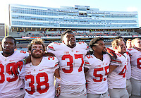 Ohio State Buckeyes linebacker Joshua Perry (37) stand with Ohio State Buckeyes linebacker Craig Fada (38) and Ohio State Buckeyes linebacker Camren Williams (55) following their game at Memorial Stadium in Champaign, Ill on November 14, 2015. (Columbus Dispatch photo by Brooke LaValley)
