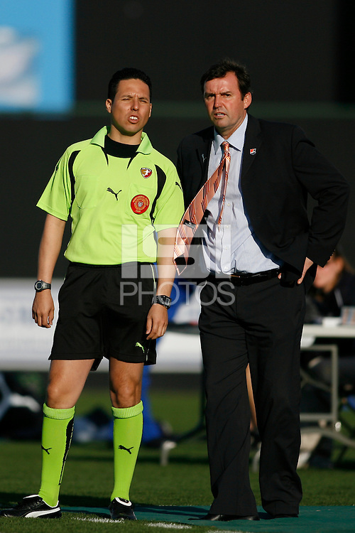 Sky Blue FC head coach Ian Sawyers talks with fourth official Jose Carlos Rivero. The Los Angeles Sol defeated Sky Blue FC 2-0 during a Women's Professional Soccer match at TD Bank Ballpark in Bridgewater, NJ, on April 5, 2009. Photo by Howard C. Smith/isiphotos.com