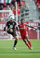 05 May 2012: D.C. United midfielder Dwayne De Rosario #7 and Toronto FC midfielder Julian de Guzman #6 in action during an MLS game between DC United and Toronto FC at BMO Field in Toronto.