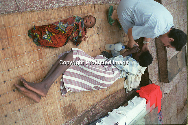 .Victims of the floodings in Mozambique gets some care in a church in Chokwe , 200 km north of Maputo. Staff from Medicin sans Frontier are helping the people in this area..March-2000..Photo Per-Anders Pettersson/ iAfrika Photos