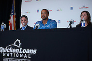 Bethesda, MD - May 19, 2014: Pro golfer Tiger Woods (c) holds a news conference at the Congressional Country Club in Bethesda, MD to discuss the Quicken Loans National golf tournament. Seated L-R, Steve Durante, president of the Congressional Country Club and Heather Lovier, vice president of Quicken Loans. The proceeds of the tournament benefit the Tiger Woods Foundation.   (Photo by Don Baxter/Media Images International)