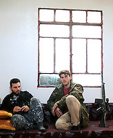 photographer: Rick Findler/Borderline News..17.01.13 Soldiers belonging to the Free Syrian Army drink relax after a mission to have a closer look at Minnagh Military Airport. They are hoping to plan an offensive attack to take the airport from Assad control outside of Aleppo