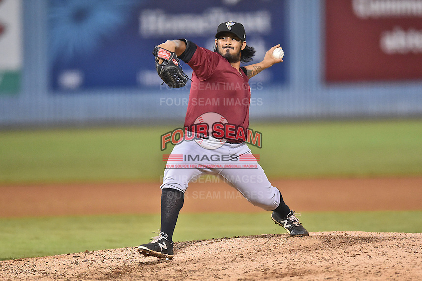Savannah Sand Gnats pitcher Paul Paez (12) delivers a pitch during game one of the Southern Division South Atlantic League Playoffs against the Asheville Tourists on September 9, 2015 in Asheville, North Carolina. The Tourists defeated the Sand Gnats 5-1. (Tony Farlow/Four Seam Images)