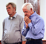 Two men pray during church service at Rockhouse Pentecostal Church on Wednesday, Oct. 9, 2013, in Hyden, Ky. Photo by Tessa Lighty
