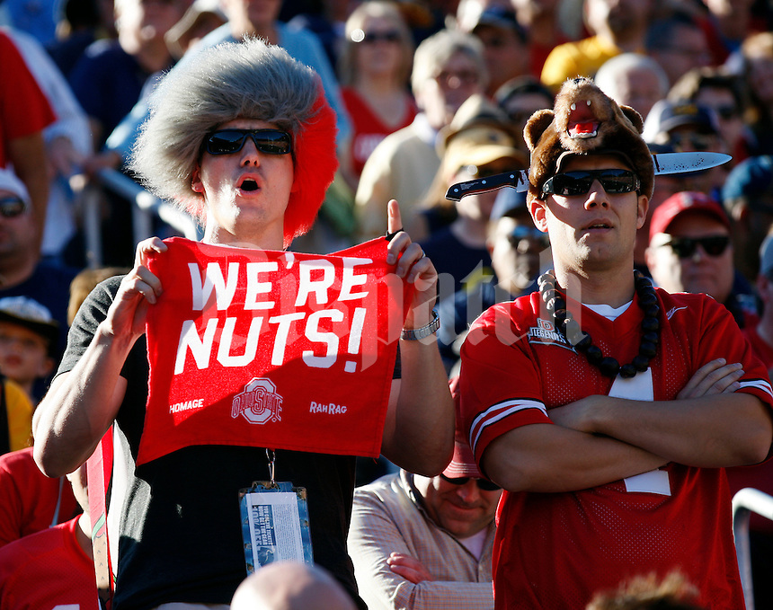 Ohio State fans Douglas Horning (left), 35, from Akron and KEvin Reber, 31, from Sylvania cheer on the Buckeyes during the NCAA football game against California at Memorial Stadium in Berkeley, California on Sept. 14, 2013. (Adam Cairns / The Columbus Dispatch)