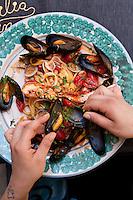 Fettuccine allo Scoglio con vongole, calamari, gamberetti, scampi (Fettuccine with mussels, clams, calamari and shrimps) at Sicilia in Tavola, Siracusa, Sicily