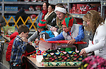 Volunteers also provide wrapping for nearly 170 elementary students served by the Holiday with a Hero program at Walmart in Carson City, Nev., on Tuesday, Dec. 17, 2013. The community event partners military, firefighters, law enforcement and medical personnel with local Students in Transition to provide them with Christmas presents. <br /> Photo by Cathleen Allison