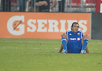 03 July 2013: Montreal Impact defender Alessandro Nesta #14 sits exhausted at the end of an MLS game between the Montreal Impact and Toronto FC at BMO Field in Toronto, Ontario Canada.<br /> The game ended in a 3-3 draw.