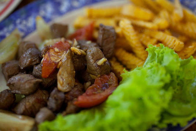Bo Luc Lac, or Shaken Beef, is pan-fried with tomatoes, onions, green peppers and garlic and garnished with french fries from the Orchid Restaurant on Con Son Island, part of the Con Dao Islands.The 16 mountainous islands and islets are situated about 143 miles southeast of Ho Chi Minh City in Vietnam, in the South China. Photo taken Thursday, May 6, 2010...Kevin German / LUCEO For the New York Times