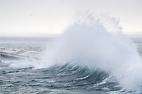 A close-up of Lake Superior wave crashing in to a breakwater. Marquette, MI