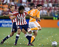 Chivas USA defender Claudio Suarez (2) pushes Houston Dynamo forward Brian Ching (25) off the ball.  The Houston Dynamo tied CD Chivas USA 0-0 at Robertson Stadium in Houston, TX on May 3, 2008.
