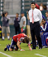 Chivas USA midfielder Blair Gavin (18) doubles over in pain in front of Chivas USA headcoach Martin Vasquez. CD Chivas USA defeated the Columbus Crew 3-1 at Home Depot Center stadium in Carson, California on Saturday July 31, 2010.