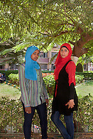 Selma and Maryam pose in the campus of Ain Shams University in Cairo, where they study. Cairo, Egypt. October 9th, 2012.