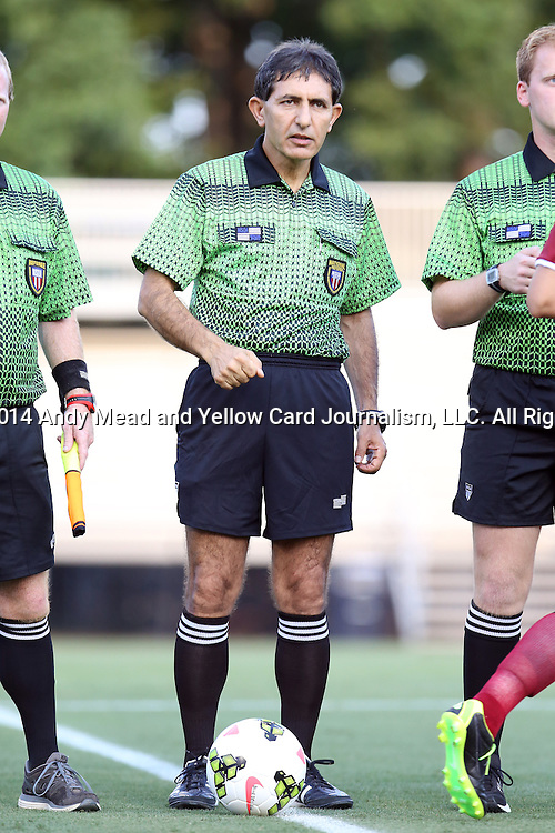 14 August 2014: Referee Abbas Piran. The Duke University Blue Devils hosted the University of South Carolina Gamecocks at Koskinen Stadium in Durham, NC in a 2014 NCAA Division I Women's Soccer preseason match. Duke won the exhibition 2-0.