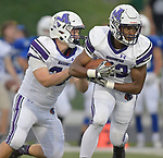 Mascoutah quarterback Devon Ross (left) hands off to running back Devin Wills. Columbia played Mascoutah on Saturday August 31, 2019 in a football game that was never started on Friday night due to bad storms.<br /> Tim Vizer/Special to STLhighschoolsports.com