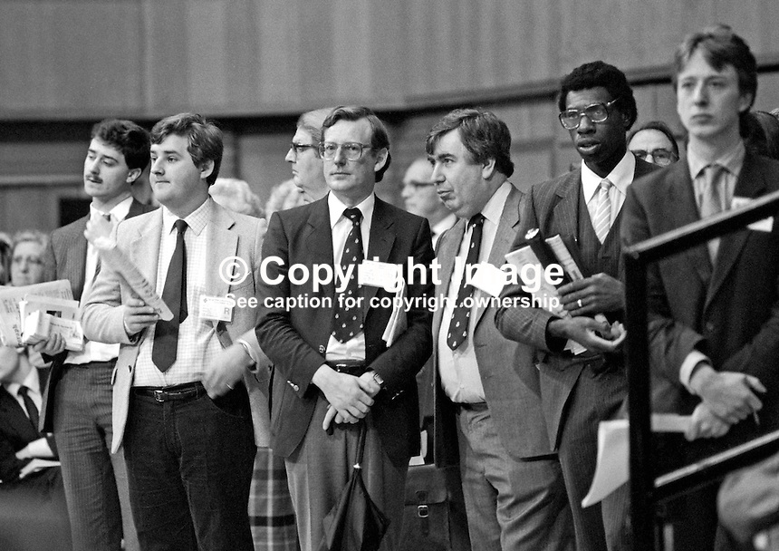 Prominent members of the Ulster Unionist Party, David Trimble, dark jacket &amp; hands clasped, with Jack Allen, Londonderry, light coloured suit, listening to a standing room only session at the annual conference of the UK Conservative Party. 19840161DT1.<br /> <br /> Copyright Image from Victor Patterson,<br /> 54 Dorchester Park, <br /> Belfast, UK, BT9 <br /> <br /> t1: +44 28 9066 1296 (from Rep of Ireland 048 90661296)<br /> t2: +44 28 9002 2446 (from Rep of Ireland 048 9002 2446)<br /> <br /> m: +44 7802 353836<br /> <br /> e: victorpatterson@me.com<br /> www.victorpatterson.com<br /> <br /> Please see my Terms and Conditions of Use at www.victorpatterson.com. It is IMPORTANT that you familiarise yourself with them.<br /> <br /> Images used on the Internet must be visibly watermarked i.e. &copy; Victor Patterson<br /> within the body of the image and copyright metadata must not be deleted. Images <br /> used on the Internet have a size restriction of 4kbs and will be chargeable at current<br />  NUJ rates unless agreed otherwise.<br /> <br /> This image is only available for the use of the download recipient i.e. television station, newspaper, magazine, book publisher, etc, and must not be passed on to any third <br /> party. It is also downloaded on condition that each and every usage is notified within 7 days to victorpatterson@me.com<br /> <br /> The right of Victor Patterson to be identified as the author is asserted in accordance with The Copyright Designs And Patents Act (1988). All moral rights are asserted.