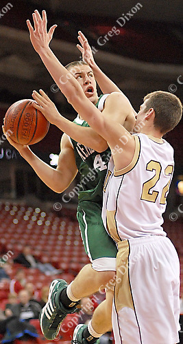 6' James Madison Memorial sophomore guard Fred Ringhand shoots past Edgewood's Nick Palm in the Memorial Spartans' 53-36 win over the Crusaders on Wednesday at the Kohl Center in Madison, Wisconsin