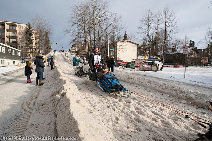 Ketil Reitan and team run past spectators on the bike/ski trail with an Iditarider in the basket during the Anchorage, Alaska ceremonial start on Saturday, March 5, 2016 Iditarod Race. Photo by O'Hara Shipe/SchultzPhoto.com