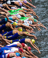09 JUL 2011 - PARIS, FRA - Competitors dive into the water at the start of the men's French Grand Prix series race .(PHOTO (C) NIGEL FARROW)