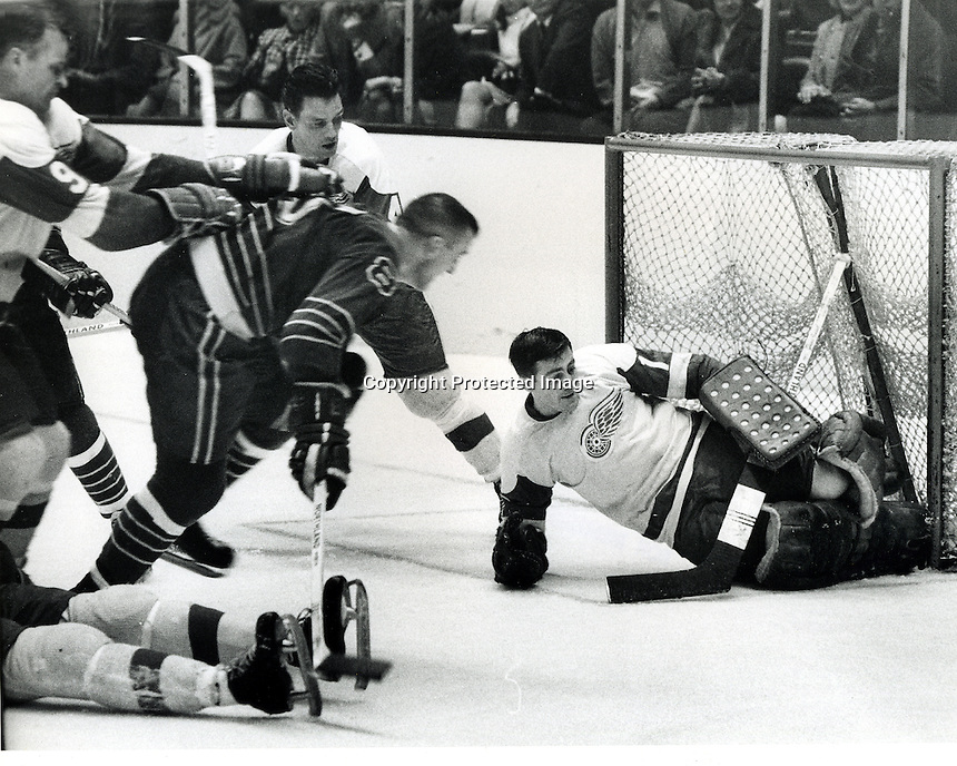 Detroit RedWings vs. California Seals NHL hockey, Seals Gerry Ehman shoots toward RedWing goalie Roy Edwards. (photo/Ron Riesterer)