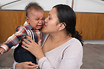 5 month old baby boy at home crying held by mother comforted