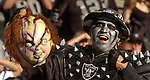 Raider fan holds up Chucky doll head to intimidate Buccaneers head coach Jon Gruden on Sunday, September 26, 2004, in Oakland, California. The Raiders defeated the Buccaneers 30-20.