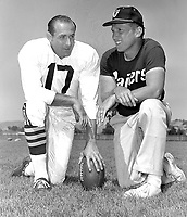 Oakland Raider coach Al Davis with his quarterback Cotten Davidson at training camp 1963..(photo Ron Riesterer)