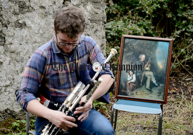 Piper Fergal Breen performs at the unveiling of a memorial at the house where the blind piper Patrick O Brien was born at Labasheeda. Photograph by John Kelly.