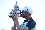 Gainesville, VA - August 2, 2015: Tournament Champion Troy Merritt celebrates by kissing the Quicken Loans Trophy after winning the 2015 Quicken Loans Nationals at the Robert Trent Jones Golf Club in Gainesville, VA. August 2, 2015.  (Photo by Philip Peters/Media Images International)