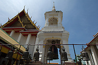The Wat Kalayanamit, on the Chao Phraya River in Bangkok near the mouth of the Khlong Bangkok Yai, boasts Thailand's biggest chofa (roof finial), biggest bell and largest indoor sitting Buddha.