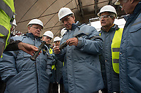Group of supervisors at the construction site of the arch confinement for 4th reactor of Chernobyl Power Plant.