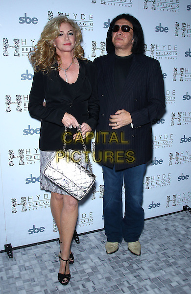 Shannon Tweed, Gene Simmons.Nick Simmons celebrates his 23rd birthday with family jewels and performance at Hyde Bellagio, Las Vegas, Nevada, USA, 9th March 2012..full length dress  back jacket couple husband wife jeans sunglasses blazer silver chanel bag .CAP/ADM/MJT.© MJT/AdMedia/Capital Pictures.