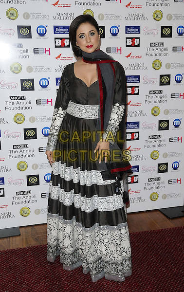 Urmila Matondkar.attended the Manish Malhotra Fashion Extravaganza, Grosvenor House Hotel, Park Lane, London, England..February 23rd, 2013.full length black grey gray white lace dress scarf .CAP/CAN.©Can Nguyen/Capital Pictures.