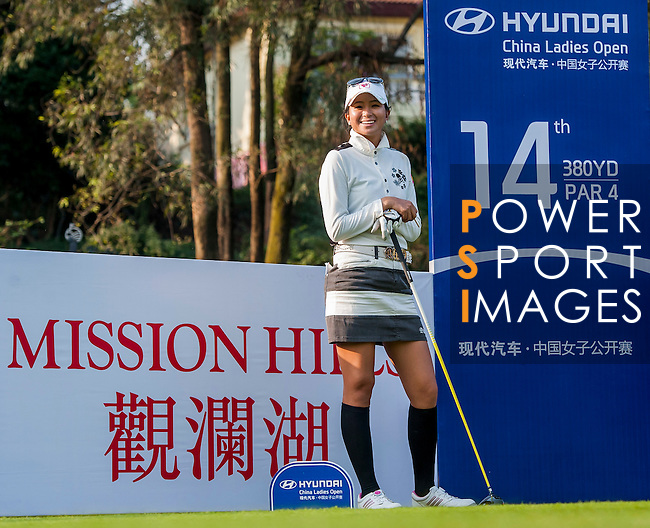 Ai-Chen Kuo of Chinese Taipei looks on during the Hyundai China Ladies Open 2014 on December 09 2014 at Mission Hills Shenzhen, in Shenzhen, China. Photo by Xaume Olleros / Power Sport Images