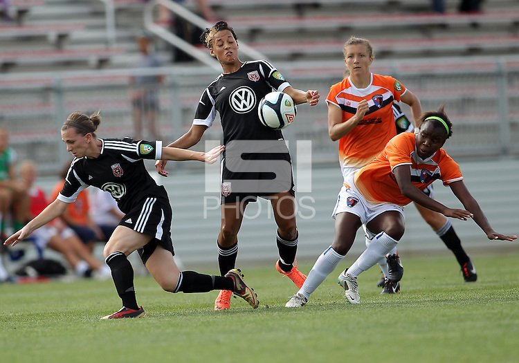 BOYDS, MARYLAND - July 22, 2012:  Lianne Sanderson (10) of DC United Women gets the ball between Mikaela Howell (8) and Sabbath McKiernan Allen (15) of the Charlotte Lady Eagles during the W League Eastern Conference Championship match at Maryland Soccerplex, in Boyds, Maryland on July 22. DC United Women won 3-0.