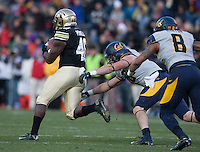 California defender Lucas King tries to tackle Colorado tailback Christian Powell during the game at Folsom Field in Boulder, Colorado on November 16th, 2013.  Colorado defeated California, 41-24.