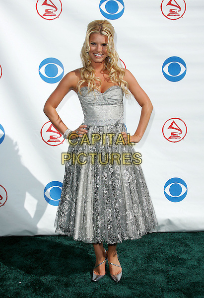 JESSICA SIMPSON.The 5th Annual Latin Grammy Awards held at The Shrine Auditoreum in Los Angeles, California.September 1st, 2004.full length, hands on hips, silver, grey, gray, metallic dress, lacy.www.capitalpictures.com.sales@capitalpictures.com.Copyright by Debbie VanStory